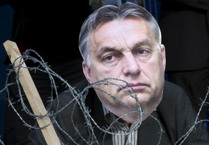 867136-an-avaaz-s-activist-wears-a-mask-depicting-hungary-s-prime-minister-viktor-orban-behind-barbed-wire-